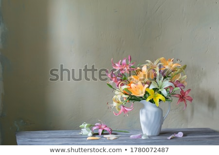 yellow and white lilies in vase stock photo © mady70