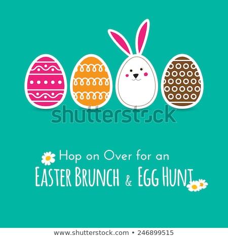 Rabbit decorates Easter egg Stock photo © adrenalina
