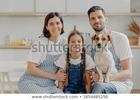 dad mom and daughter together in the kitchen stock photo © tekso