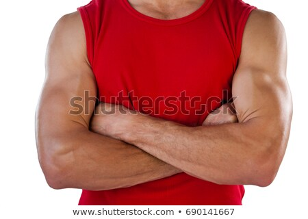Midsection of sports player with arms crossed Stock photo © wavebreak_media