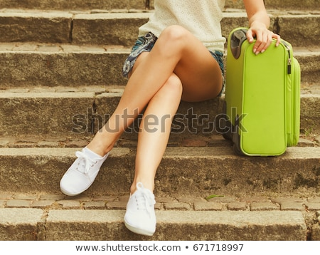 Long woman's legs on a stairs Stock photo © Nobilior