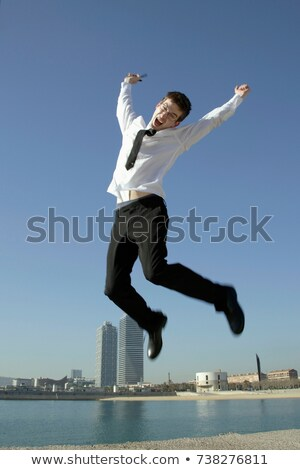 Business man jumping by seafront Stock photo © IS2