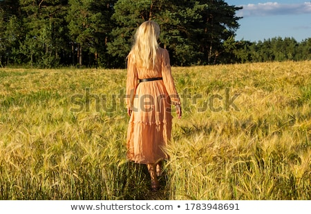 blonde woman standing on grass stock photo © is2