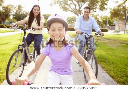 Család lánygyermek bicikli út nyár anya Stock fotó © IS2