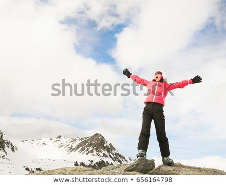 Woman shouting from snowy mountain top Stock photo © IS2