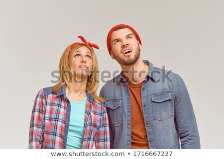 Two boys looking over wall at view Stock photo © IS2