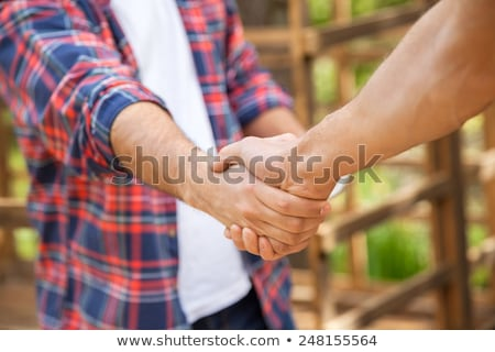 Cropped image of colleagues shaking hands Stock photo © wavebreak_media
