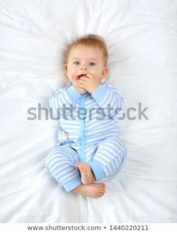 baby · binnenshuis · glimlachend · home · jongen · ontspannen - stockfoto © is2