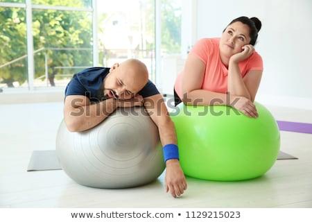 Esgotado mulher adormecido exercer bola Foto stock © IS2
