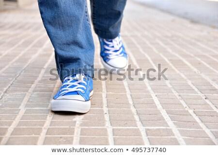 woman walking along sidewalk stock photo © is2