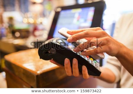 Kız kasiyer örnek kadın para Stok fotoğraf © lenm