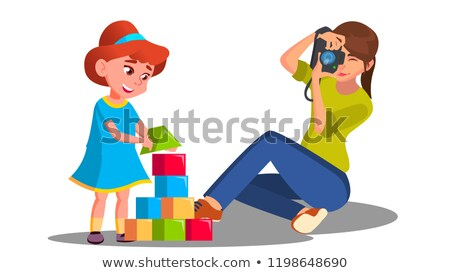 mother taking pictures of her child playing with toys vector isolated illustration stock photo © pikepicture