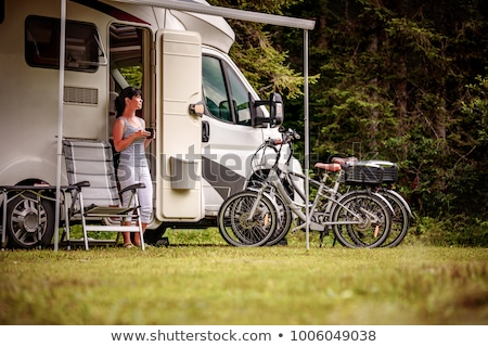 Woman with a mug of coffee near the camper. Caravan car Vacation Stock photo © cookelma