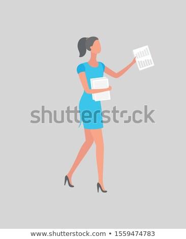 Kadın mavi elbise yüksek topuklu liste kâğıt Stok fotoğraf © robuart