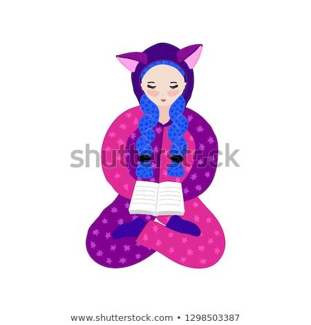 Girl in kigurumi pajama reading book. Hand drawn cute cartoon character in jumpsuit with ears. Pasti Stock photo © user_10144511