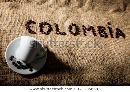 Coffee beans shaped as cup over a jute cloth Stock photo © alphaspirit