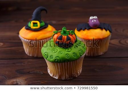 Minitorta halloween dekoráció asztal étel sütés Stock fotó © dolgachov