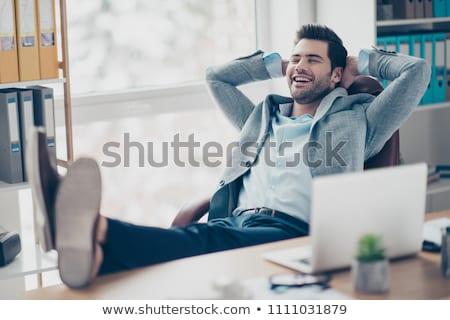 elegant man sitting on chair with elbow on leg Stock photo © feedough