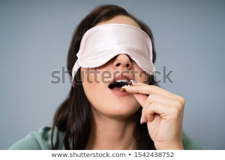 Bekötött szemű fiatal nő tesztelés étel portré szem Stock fotó © AndreyPopov