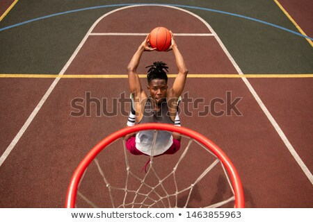 African young basketballer making effort while throwing ball in basket Stock photo © pressmaster
