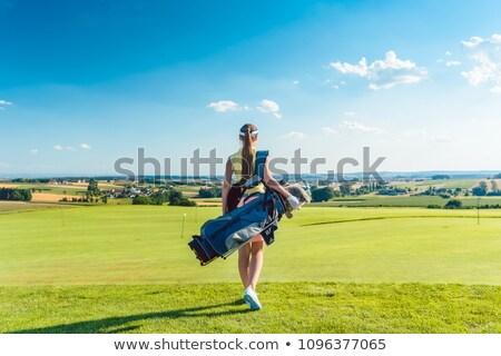 Vista posteriore donna sacca da golf golf club Foto d'archivio © Kzenon