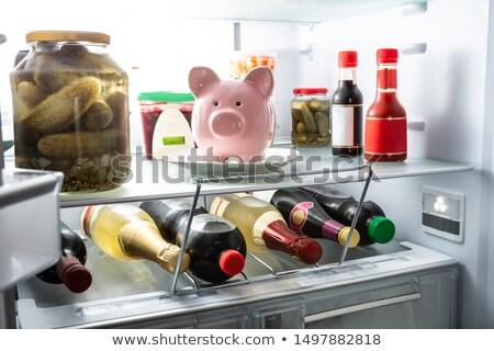 Piggy Bank белый пластина внутри холодильнике розовый Сток-фото © AndreyPopov