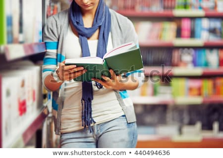 Student reads book in library Stock photo © jossdiim