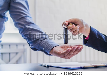 businessman signing contract with keys on it stock photo © andreypopov