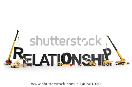 Developing a relationship: Machines building word. Stock photo © lichtmeister