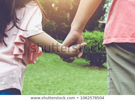 Alegre criança manter pai ou mãe mão verão Foto stock © Lopolo
