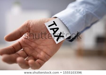 Businessperson Showing Unfair Tax Advantage In His Sleeve Stock photo © AndreyPopov