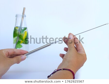 Woman Cleaning Reusable Metal Straw Stock photo © AndreyPopov