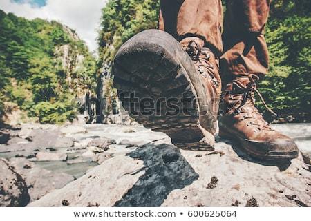 Feet trekking boots hiking Traveler alone outdoor wild nature Lifestyle Travel extreme survival conc Stock photo © galitskaya