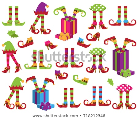 christmas card with elf legs and presents stock photo © balasoiu