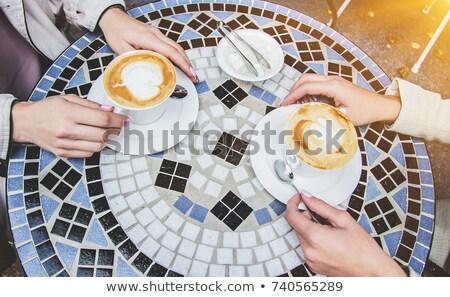 Kezek kettő fiatal barátságos nők cappucchino Stock fotó © pressmaster