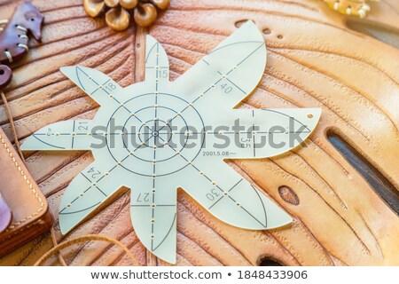Cutting corner of leather Stock photo © pressmaster