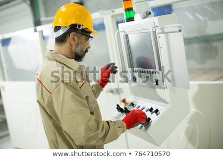 Handsome mature man working in furniture factory Stock photo © boggy
