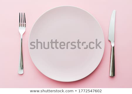 Empty plate and cutlery as mockup set on pink background, top tableware for chef table decor and men Stock photo © Anneleven