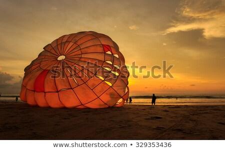 Man parasailing at sunset Stock photo © raywoo