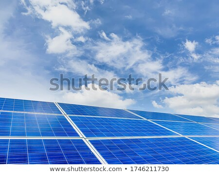 Rows of PV Solar Panels Mounted on Roof Blue Sky  Stock photo © Qingwa