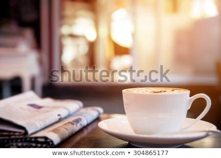 Kawy gazety rano okulary do czytania zielone roślin Zdjęcia stock © dehooks