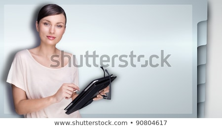closeup of beautiful woman with electronic tablet against web si stock photo © hasloo