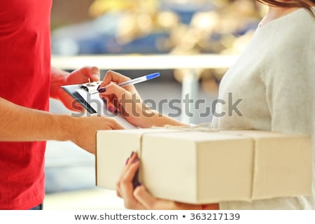 Woman delivering parcel Stock photo © photography33
