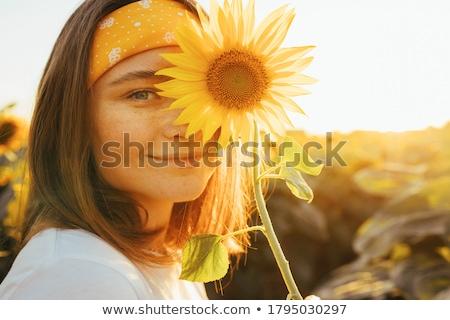 happy woman in sunflower field stock photo © dashapetrenko