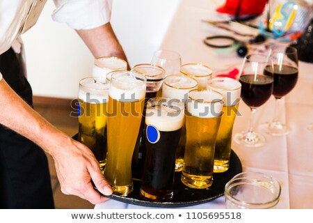 Waiter carrying tray of beer Stock photo © photography33