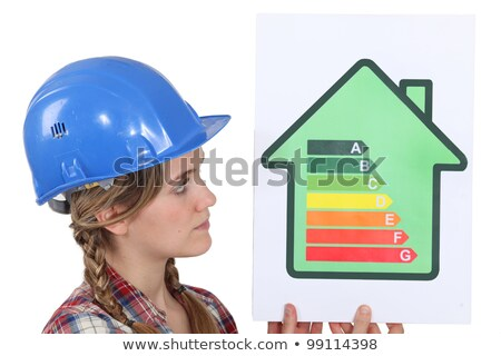 Female housebuilder with an energy rating sign Stock photo © photography33