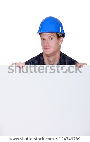 craftsman holding a poster and grimacing Stock photo © photography33