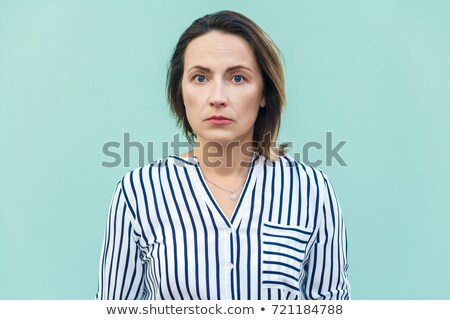 blond woman looking nervous Stock photo © photography33