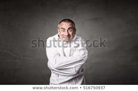 Stock photo: Insane man in a straitjacket