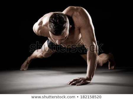 Man doing one-armed push-up Stock photo © photography33